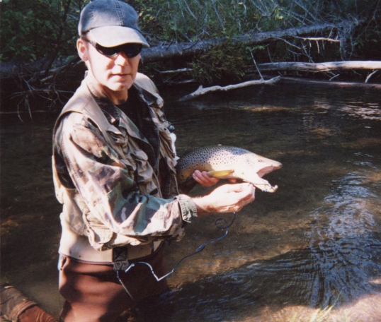 Feral with a hook-jawed brown trout, Pigeon River
